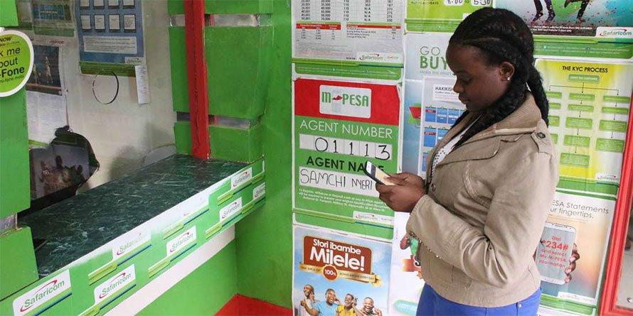 A customer transacts at an M-Pesa agent's shop (BD)