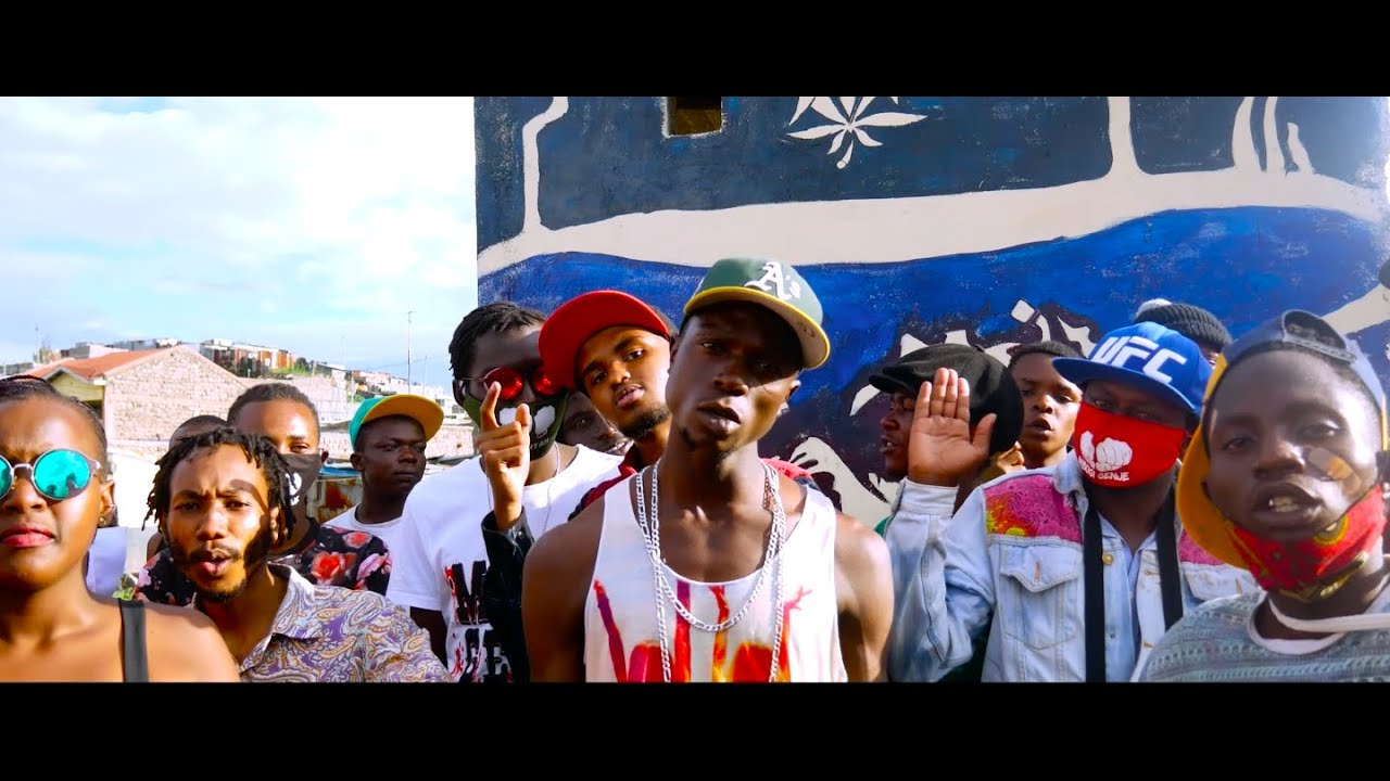 Smady Tingz of Mbogi Gnje (Centre) in the video for 'Bloody War'