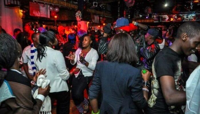 Revelers dancing at a nightclub in Nairobi