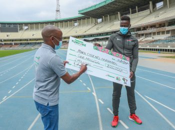 Mark Otieno (R) with Safaricom CEO Peter Ndegwa after the telco unveiled a Ksh1 million sponsorship for the sprinter as he prepares for the Olympic games to be held in Tokyo, Japan.