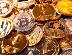 Frankfurt, Hesse, Germany - April 17, 2018: Many coins of various cryptocurrencies. [Photo: iStock/gopixa]